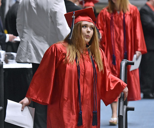(Brad Davis/The Register-Herald) An Independence graduate breathes a sigh of relief as her long journey through public school concludes Saturday morning at the Beckley-Raleigh County Convention Center.