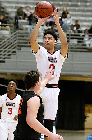 (Brad Davis/The Register-Herald) Greater Beckley Christian's Johnathon Moore shoots from three-point range as Summers County's Andrew Richmond defends during the Crusaders' win over the Bobcats Friday night at the Beckley-Raleigh County Convention Center.