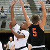 (Brad Davis/The Register-Herald) Greater Beckley Christian's Caleb Clark drives to the basket as Summers County's Samuel Wykle defends during the Crusaders' win over the Bobcats Friday night at the Beckley-Raleigh County Convention Center.
