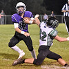 (Brad Davis/The Register-Herald) James Monroe's Monroe Mohler cuts right to avoid Wyoming East defender Michael Elkins Friday night in Lindside.
