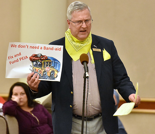 (Brad Davis/The Register-Herald) Tim Bolick, benefit administrator with the West Virginia School Service Personnel Association, speaks during a PEIA public hearing wearing yellow, the color symbolizing service employees, Wednesday night at Tamarack.