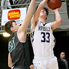 (Brad Davis/The Register-Herald) James Monroe's McKinley Mann drives and scores as Wyoming East's Jacob Bishop defends during Big Atlantic Classic action Wednesday night at the Beckley-Raleigh County Convention Center.