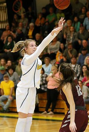 (Brad Davis/The Register-Herald) Greenbrier East's Haley McClure shoots from three-point range as Woodrow Wilson's Cloey Frantz defends Saturday night in Fairlea.