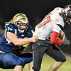 Shady Spring's Terymykal Alexander (77) tackles Liberty's Drew Clark (10) during their high school football game Friday in Shady Spring. (Chris Jackson/The Register-Herald)