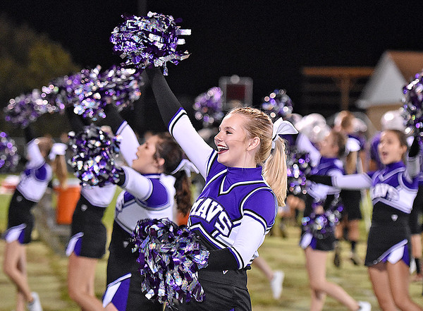 (Brad Davis/The Register-Herald) The James Monroe cheerleaders perform during their game against Wyoming East Friday night in Lindside.