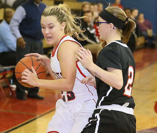 (Brad Davis/The Register-Herald) Independence's MaKenzie Holley drives around PikeView's Cheyanne Graham Thursday night in Coal City.