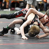 Beckley's Brayden Jones tries to pin Ground Zero's Sawyer Bond during their wrestling match as part of the WVYWA State Tournament in Beckley Saturday. Bond won the match. (Chris Jackson/The Register-Herald)