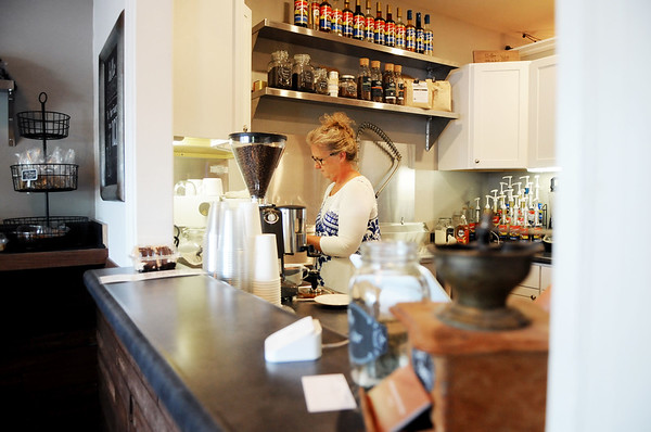 Appalachian Coffee House owner Debbie Bounds pours an espresso shot at the store in Mt. Nebo. (Chris Jackson/The Register-Herald)
