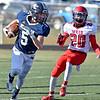 (Brad Davis/The Register-Herald) Nicholas County's Luke LeRose gets around Weir's Deon Trupiano during a kick return Saturday afternoon in Summersville.