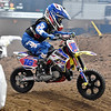 (Brad Davis/The Register-Herald) Huntington's Brody Adkins, 8, skips over the whoops as he competes during the weekend's Tristate MX dirt bike racing event Saturday night at the Beckley-Raleigh County Convention Center.