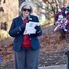 (Brad Davis/The Register-Herald) Mt. Hope resident Brenda Troitino leads the town's annual Veteran's Day ceremony in front of the War Memorial on Main Street Sunday afternoon.