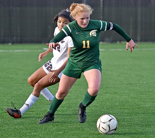 (Brad Davis/The Register-Herald) Greenbrier East's Kate Perkins wins a battle for possession with George Washington's Destiny Jackson Thursday evening at the YMCA Paul Cline Memorial Sports Complex.