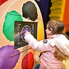 "(Brad Davis/The Register-Herald) Five-year-old Emily Spence plays on one of the interactive displays inside the Youth Museum's new exhibit, ""Framed, Step into the Art,"" November 24."