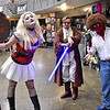 "(Brad Davis/The Register-Herald) Comic book antihero Harley Quinn (Left), a.k.a. Teagan Kelley of Sissonville, ""Tony Wan Kenobi,"" (middle) a.k.a. Adam Hill of Charleston, and ""Bob Ross Deadpool,"" a.k.a. Hurricane resident Steve Pauley, notice the camera and jump into pose as the cosplayers patrol the floor during Causeacon Saturday afternoon at the Beckley-Raleigh County Convention Center."