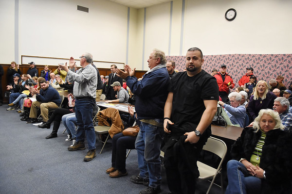 People react to the Raleigh County Commission voting no to allow Mabscott to annex a portion of Robert C. Byrd Dr. from Fitzpatrick Road intersection to Sophia city limits Tuesday in Beckley. (Chris Jackson/The Register-Herald)