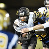 Liberty's Logan Dodrill (13) is tackled by Shady Spring's Stephen Crook (52) and Dane Chapman (84) during their high school football game Friday in Shady Spring. (Chris Jackson/The Register-Herald)