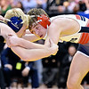 (Brad Davis/The Register-Herald) Independence's Liam Lusher takes on East Fairmont's Brock Whorton for the Class AA/A 126-pound championship during State Wrestling Tournament action Saturday night at the Big Sandy Arena. East Fairmont's Whorton won the match.