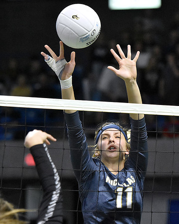 (Brad Davis/The Register-Herald) An injured hand doesn't stop Nicholas County's Meaghan Willis from stepping up to block Winfield's spikes during State Volleyball Tournament action Friday afternoon at the Charleston Civic Center.
