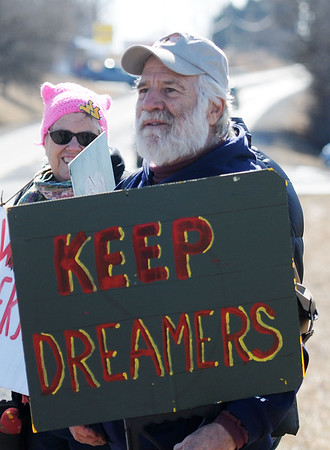 "Chris Chanlett, from Hinton, holds a sign that reads ""Keep Dreamers"" during a protest as part of the Protest, March & Rally, hosted by Greater Greenbrier Valley Indivisible and Women's March, at the entrance of the Lewisburg Airport waiting for arrivals of the Republican party for their retreat at The Greenbrier on Wednesday. (Chris Jackson/The Register-Herald)"