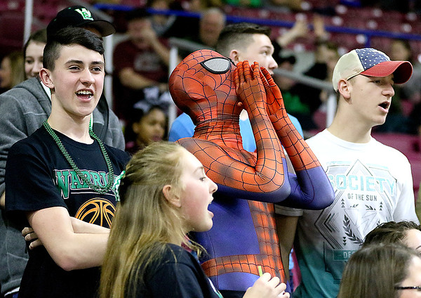 (Brad Davis/The Register-Herald) Wyoming East students cheer on their classmates on the court during the Lady Warriors' State Tournament win over Wayne Friday morning at the Charleston Civic Center.