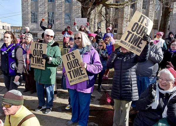 """(Brad Davis/The Register-Herald) Area residents react as activists, concerned citizens and local officials speak during the """"It's Our Time"""" rally marking the one-year anniversary of the Women's March Saturday morning in Beckley's Showmaker Square."""