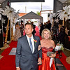 (Brad Davis/The Register-Herald) Dancers Deb Evans and Noah Kapp, front, make their way in along the red carpet during the opening moments of the United Way of Southern West Virginia's Dancing With the Stars fundraising event Friday night at the Beckley-Raleigh County Convention Center.