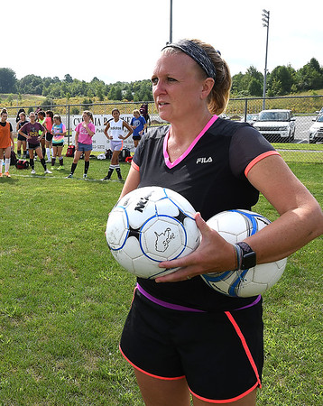 Woodrow Wilson Soccer coach Julie Agnor, watching her team practice at the YMCA Paul Cline Memorial Youth Sports Complex Wednesday morning.<br /> (Rick Barbero/The Register-Herald)