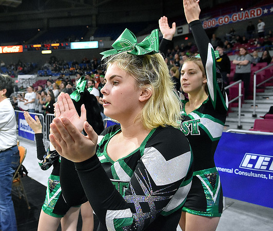 (Brad Davis/The Register-Herald) Wyoming East cheerleaders pull for their classmates on the court during the Lady Warriors Class AA State Championship game against North Marion Saturday afternoon at the Charleston Civic Center.