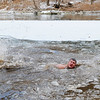 "Benjamin Bailey swims in the icy New River after participating in the annual New Year's Day Polar Plunge at Fayette Station on Monday. ""I want to go back in,"" said Bailey after getting out of the water where temperatures in the low teens were colder than the water. (Chris Jackson/The Register-Herald)"