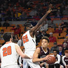 Eddie Christian, of Woodrow Wilson, right, guarded by Grant Harman, left, and Josephus Bokey, of Martinsburg during the quarter-final game of the Class AAA Boys State Basketball Tournament held at the Charleston Civic Center. Martingburg won 58-48<br /> (Rick Barbero/The Register-Herald)