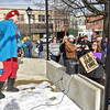 """(Brad Davis/The Register-Herald) Concerned citizen and activist DL Hamilton, left, enthusiastically leads the crowd in song during the """"It's Our Time"""" rally marking the one-year anniversary of the Women's March Saturday morning in Beckley's Showmaker Square."""