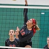 (Brad Davis/The Register-Herald) Liberty's Morgan Marty rips a spike against Meadow Bridge August 29 in Fayetteville.