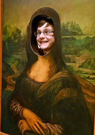 """(Brad Davis/The Register-Herald) 13-year-old Tommy Maynor has some fun doing his best Mona Lisa impression inside the Youth Museum's new exhibit, """"Framed, Step into the Art,"""" November 24."""