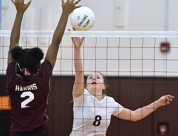 (Brad Davis/The Register-Herald) Woodrow Wilson's Bryce Knapp races in to tap the ball back over as George Washington's Maya Harris during the Class AAA Regional Volleyball tournament Saturday afternoon in Beckley.