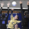 (Brad Davis/The Register-Herald) Greenbrier West's Logan Vandall spikes the ball as Tyler Consolidated's Emily Lancaster, left, and Regan Smith, right, try to block during State Volleyball Tournament action Friday morning at the Charleston Civic Center.