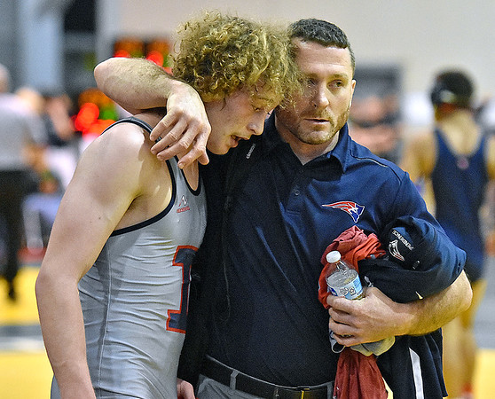 (Brad Davis/The Register-Herald) Independence's Alex and Jeremy Hart following a win during State Wrestling Tournament action Friday night at the Big Sandy Arena.