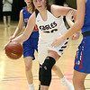 (Brad Davis/The Register-Herald) Woodrow Wilson's Laken Ball drives and scores against Morgantown during Big Atlantic Classic action Thursday night at the Beckley-Raleigh County Convention Center.