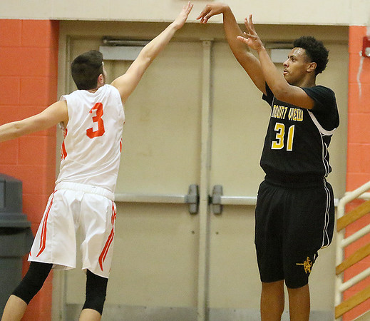 (Brad Davis/The Register-Herald) Mount View's Latrell Hairston shoots from three-point range as Summers County's Cordell Meadows defends Friday night in Hinton.