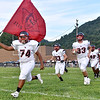 (Brad Davis/The Register-Herald) Oak Hill takes the field Friday night in Smithers.