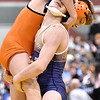 (Brad Davis/The Register-Herald) Greenbrier West's Eric Crowe takes on Wirt County's A.J. Garrett in a 120-pound weight class matchup during state wrestling tournament action Thursday night at Huntington's Big Sandy Arena.