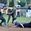 (Brad Davis/The Register-Herald) Greenbrier West's Rachel Adkins dives to steal 2nd base as the throw gets to Fayetteville infielder Nikki Holbrook, far left, during the Cavaliers' rain-soaked thriller against the Pirates Wednesday night.