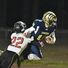 Shady Spring quarterback Drew Clark (10) is tackled by Liberty's Ryan Simms(22) during their high school football game Friday in Shady Spring. (Chris Jackson/The Register-Herald)