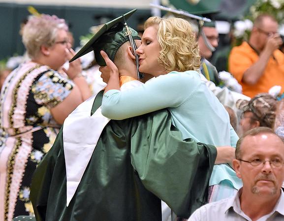 (Brad Davis/The Register-Herald) Graduating Wyoming East seniors seek out their family members during the school's flower ceremony prior to their commencement Friday night in New Richmond.