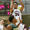 (Brad Davis/The Register-Herald) Woodrow Wilson's Micah Hancock pulls up for a jump shot as Huntington's Kris Brown defends Wednesday night at the Beckley-Raleigh County Convention Center.