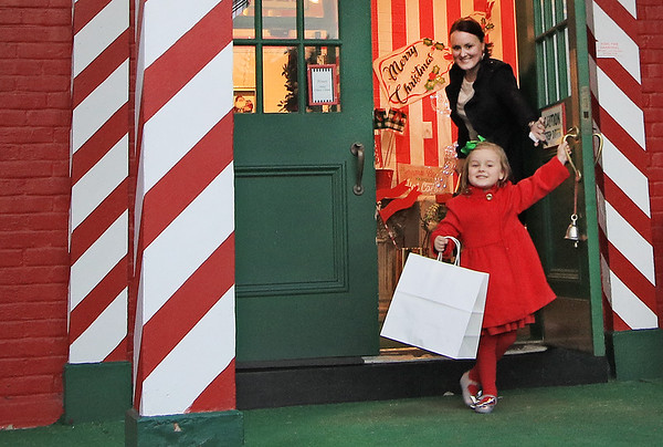 Samia Persinger, 3, steps out of the Greenbrier Christmas Shop at the Depot after shopping with her mother, Nicole Persinger in White Sulphur Springs Monday. The family from Charleston came to spend a few nights at the Greenbrier Resort. (Jenny Harnish/The Register-Herald)