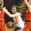 (Brad Davis/The Register-Herald) Woodrow Wilson's Cloey Frantz looks for an open teammate as she's bottled up by Parkersburg defenders Kristen Lowers, right, and Anna Umpleby Saturday afternoon in Beckley.