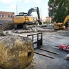 Raleigh County Commission reonovating their parking lot on Prince Street in Beckley. Shown is a large peice of concrete with a pole in the center that was on the corner of the lot that once displayed a revolving sign for JFG Coffe Shop.<br /> (Rick Barbero/The Register-Herald)