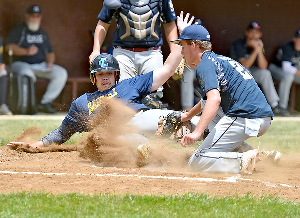 (Brad Davis/The Register-Herald) Beckley Post 32's Davey McKinney tries to score a run as Parkersburg Post 15's Colin Bryant covers the plate after a passed ball Saturday at Woodrow Wilson High School.