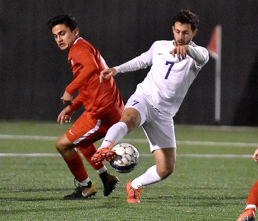 (Brad Davis/The Register-Herald) WVU Tech's Manuel Garcia battles for possession with Rio Grande's Cristobol Encina Thursday night at the YMCA Paul Clne Memorial Sports Complex.