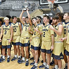 (Brad Davis/The Register-Herald) Shady Spring players pose for photos with the trophy after the Tigers defeated Woodrow Wilson for the first time in history to win the Burger King Division Championship Saturday night at the Little General Battle for the Armory.
